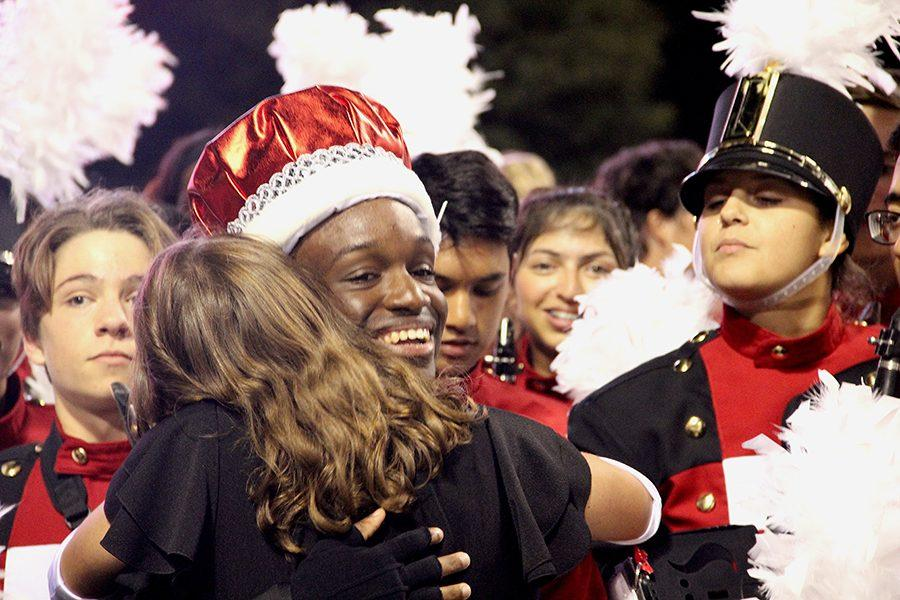 HC King Bejon Iscandri is greeted by fellow band members after being crowned.
