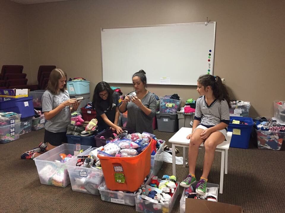 Pictured center, Ariana Chagas takes charge in the children's room at the West Houston Church of Christ.
