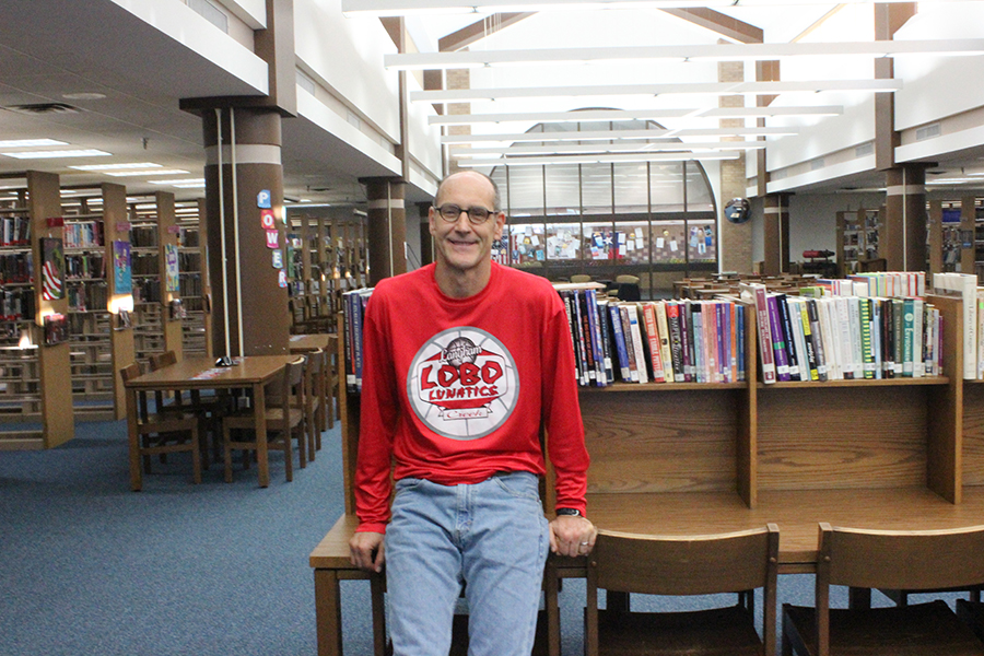 Mr. Reed in the library watching his students hard at work.