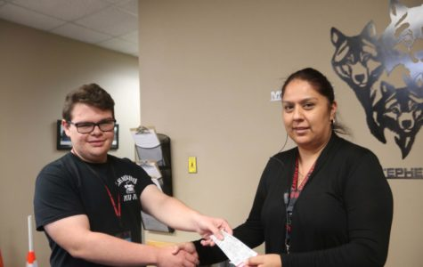 The lucky winner is AP Secretary Mrs Segundo, awarded her tickets by LCHowler Editor-in-Chief Connor Duskie.