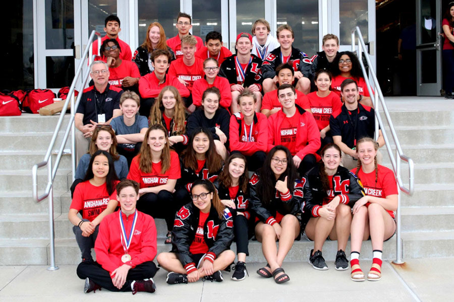 The+Varsity+swim+team+after+the+district+meet.