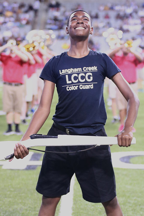 Junior Jaden Anderson catching his riffle toss