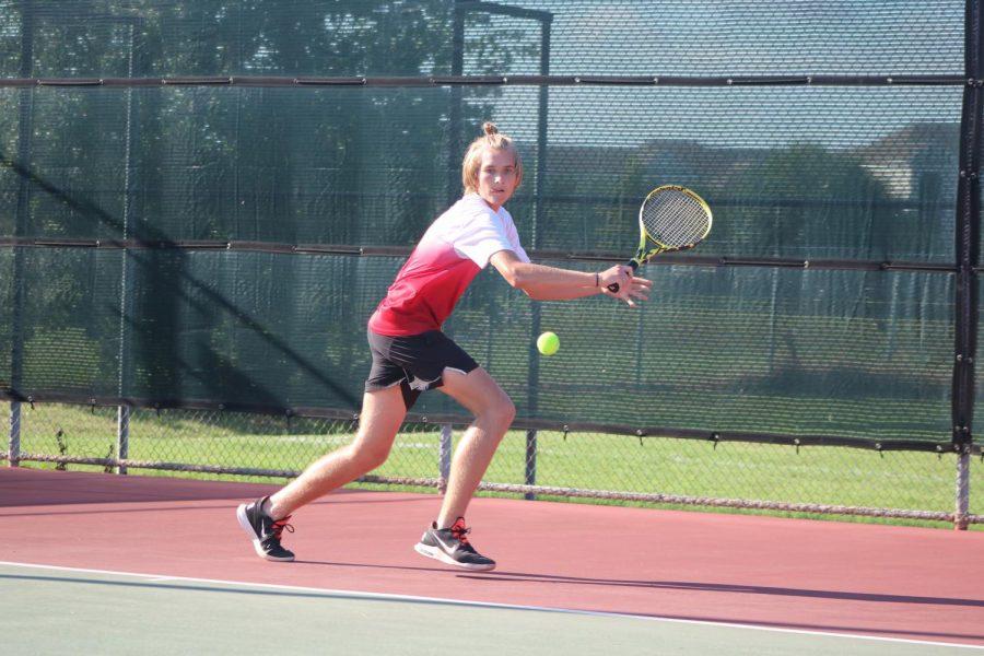 Junior Luke Playing tennis